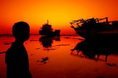 Thinking in The past...To Create the future! (AL zanki (d10b Q8)) Tags: sunset orange seascape silhouette canon landscape boats sigma kuwait q8 cokin  firstquality 1770mm alzanki