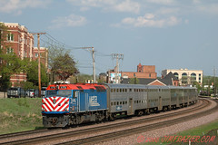 Metra 175 Eastbound into Chicago (Jim Frazier) Tags: city railroad blue red urban up buildings illinois scenery downtown cityscape mechanical may tracks structures bridges railway sunny dupage trains fair il clear equipment machinery engines infrastructure rails commuter commuting passenger machines metra 2008 railfan wedge apparatus locomotives wedgie wheaton railfanning businessdistrict dupagecounty v500 q4 explored trainwatching hvf 200805wheatontrains unionpacificstructures bookmarkprint fastpictures