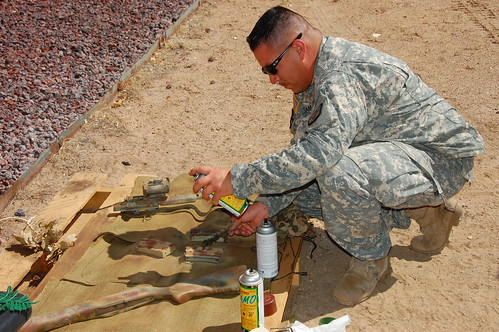 SSG Gomez painting my rifle