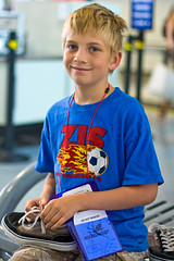 Finally Got Through Security (kcannon) Tags: family blue boy people jason southwest cute smiling bench children shoe airport search eyes gate child soccer zurich inspection adorable security terminal blonde homeland zis