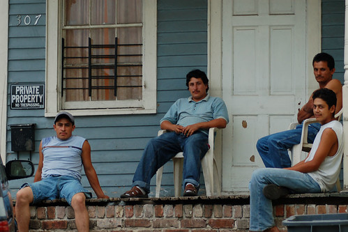 A group of Honduran workers in New Orleans, relaxing on their porch after working in construction all day.