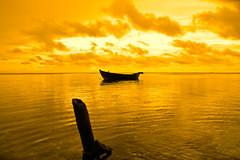 serenity (chospatis) Tags: ocean sea sky reflection nature clouds canon addo island gold boat calm serenity maldives tamron maafushi bokura photogrpher 1750mm 40d kaafu aplusphoto uniquemaldives chospatis chospo chosbe