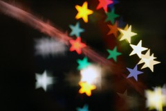 Falling Stars (F l e u r) Tags: light black night lensbaby stars star colorful bokeh sternschnuppe shootingstar fallingstar meteoroid creativeaperturekit