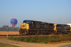SkyBird Meets CSX (Paul L. Nettles) Tags: railroad blue bird train fly flying diesel blu seagull gull aircraft hotair balloon flight engine rail loco trains envelope rails hotairballoon locomotive railfan ironhorse jonathanlivingstonseagull csx dieselengine trainspotter lighterthanair hotairballooning railroading foamer csxt railspotter railhead skybird primemover darkfuture steelrails steelrail trainfan trainfanning wwwbayouballoonadventurescom csx204 csx7911 darkfuturepaint