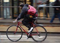 Red bike, red bag (jeremyhughes) Tags: street city red chicago man motion blur bike bicycle speed cycling movement nikon cyclist steel messenger nikkor courier panning rider messengerbag racer bikemessenger courierbag racingbike redbike redbicycle d40 18200mmf3556gvr bikecourier steelbike cyclecourier nikond40 messangerstyle