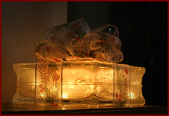 I'm sending a gift to all my wonderful flickr friends.... (bonnie5378) Tags: christmas lights gift bow glassblock supershot flickrsbest supershots citrit micarttttworldphotographyawards micartttt