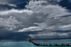 A cloudy day in the Sunny side of Life. (sharaff) Tags: trip travel blue light sea vacation music cloud holiday art me nature water beauty clouds island aperture nikon jetty line rainy nikkor maldives strom hdr highdynamicrange peer digg cs4 youtube shoken photomatix tonemapped sharaf d700 sharaff nikon2470mmf28gedafsnikkorwideanglezoomlens