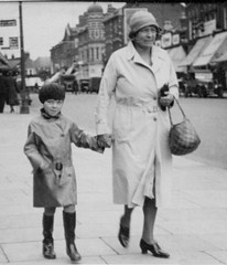 Street Photograph (theirhistory) Tags: road street woman london girl hat bag belt kid shoes child grandmother pavement coat gloves raincoat wellies handbag wellingtons mackintosh bottescaoutchouc