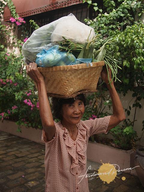 A vendor roaming around Calle Crisologo
