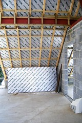 Roof Insulation Goes On