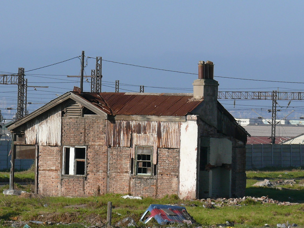 Side view of the old George Pemba cottages - chipped away by time and vandals