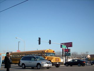 Eastbound GMC / Bluebird school bus at the intersection of Lawrence and Cumberland Avenues. Chicago Illinois. April 2007.
