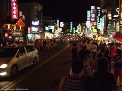 Kending at night 2 (tsai tao) Tags: road street city people car night digital store market taiwan kending fujifilmf40fd