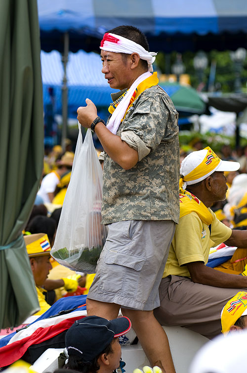 Handing out food to eaters and protesters in front of Government House, Bangkok