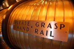 please grasp (Chris.Zilo) Tags: escalator retro rockefeller grasp