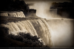 Majestic Niagara Falls (:: Igor Borisenko Photography ::) Tags: bw mist ny newyork motion fall texture water sepia dark waterfall amazing nikon bravo mood force artistic unique quality creative dramatic atmosphere niagara nikond50 falls best falling split cinematic toned powerful atmospheric allrightsreserved fiery raging highquality igorb81 igorborisenkophotography vosplusbellesphotos