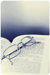 """I divide all readers into two classes; those who read to remember and those who read to forget.""  ~William Lyon Phelps (fraley_tera) Tags: 50mm reading glasses book bokeh aboutme postsecret roundedcorners bokehwhores fiddywhores bookbokeh littlemisspatriciasactions"