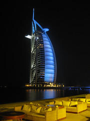 Burj al Arab (Lori Greig) Tags: travel color architecture skyscraper reflections hotel dubai extreme uae middleeast resort burjalarab sail economic iconic economy luxury unitedarabemirates cultural arabiangulf persiangulf jumeirahbeach artificialisland opulence theroyalsuiteisonly28000pernight gettyvacation2010