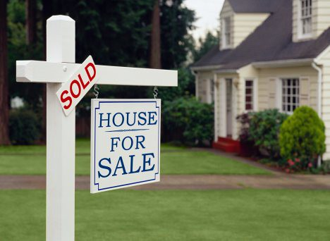 buying-a-green-home-for-sale-sold-sign