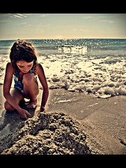 What to build... (Cody Bralts) Tags: ocean people sun shells beach water girl backlight clouds pose sand nikon warm waves think shell wave sunny human foam build