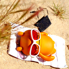 Clothing Optional (revlimit) Tags: sleeping sunglasses toys nikon vinyl towel apron explore nikkor 31 sunbathing uglydolls wage d300 55mm28macro notwearinghisapron