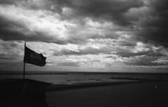 Cloudy Winter (Marcello Guardigli) Tags: old winter sea blackandwhite italy film clouds analog 35mm blackwhite seaside italia mare olympus xa2 sanbenedetto ilfordhp5 35mmfilm hp5 filmcamera olympusxa2 35 coldweather ilford adriatic manfrotto adriaticsea skb lowepro sanbenedettodeltronto film35mm blackandwhitefilm blackandwhitephotos 35mmblackandwhite analogcamera olympusfilm sekonic blackandwhite35mm 35mmcamera ilfordfilm mareadriatico blackwhitephotos oldflag ilford35mm filmblackandwhite olympusfilmcamera analogblackandwhite cloudywinter formalityisdead