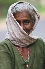 Lady in Shrouds (Emile Bremmer) Tags: world street old travel portrait people water beauty lady scarf hair real happy sadness grey nikon sad candid character sri lanka worn f4 carry nomads amulet nacklace happyness shrouds 70210mm d1x chilau abigfave peopleofsrilanka