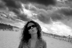 (javier.izquierdo) Tags: portrait sky bw 15fav beach sunglasses clouds geotagged sand kiss capecod massachusetts chatham sa