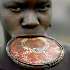 Mursi lip plate South Ethiopia (Eric Lafforgue) Tags: africa woman macro girl close dam african tribal lips clay blackpeople lip ethiopia tribe ethnic barrage mursi bodymodification tribo indigenous labret africain afrique levres indigenouspeople tribu omo thiopien etiopia ethipia ethiopie etiopa etnia 3680 ethnique tribalgirl levre lafforgue  etiopija ethnie ethiopi  lipplug ericlafforgue lipplate etiopien etipia  etiyopya  southethiopia ericlafforguecom   tribalgirls  abissnia   salinicostruttori    plateaulabial gibeiiidam gibe3dam bienvenuedansmatribu peoplesoftheomovalley lipdisclipplate piercedhole piercedlipornament