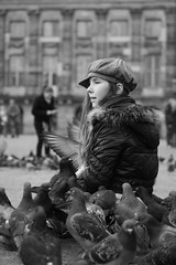 Friends! (wout.) Tags: city people urban holland nature girl dutch amsterdam birds canon pigeons streetlife efs60mm blackwhitephotos eos400d symphoniefolâtre dutchtop100