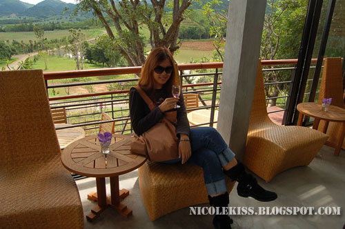 sipping wine in hua hin hills winery