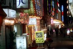 18-163 (ndpa / s. lundeen, archivist) Tags: street light people signs color film sign japan night 35mm japanese lights tokyo neon candid nick citylife streetphotography nightclub business pedestrians nightlife 1970s 18 1972 cityatnight businesses dewolf nickdewolf photographbynickdewolf reel18