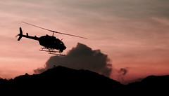 Helicopter Bell & Sunset (Jesús Gutiérrez Gómez) Tags: travel viaje sunset red sky de atardecer fly rojo colombia air jesus cementerio flight paz helicopter cielo gutierrez aeropuerto aire medellin gomez campos aero helicoptero vuelo herrera olaya sonydscw90 colourartaward