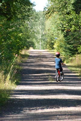 logan bikes down the lake road