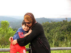 Hold on Tight (UmmAbdrahmaan @AllahuYasser!) Tags: smiling hijab jr malaysia lookoutmountain motherandson terengganu senyum aman 991 kualaterengganu eastwesthighway ibudananak ummabdrahmaan muslimmotherandchild