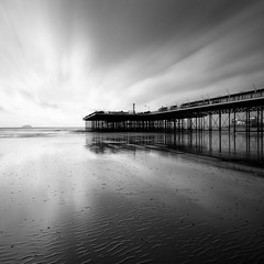 Grand Pier from beach (Adam Clutterbuck) Tags: uk longexposure greatbritain england blackandwhite bw cloud seascape reflection beach monochrome square mono coast pier blackwhite sand ruins cloudy unitedkingdom britain grand somerset bn severn coastal shore elements gb ripples bandw sq remains oe westonsupermare steep weston holm wsm greengage riun adamclutterbuck sqbw bwsq showinrecentset openedition