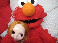 Elmo hugs me