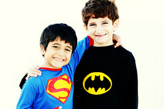 (FatoOoma Qatar ~) Tags: world lighting blue friends light boy red sun sunlight black smile smiling yellow kids canon children happy holding hug child natural action brothers super save superman batman fav hold heros doha qatar customs 400d fatooma s3ad 3thman