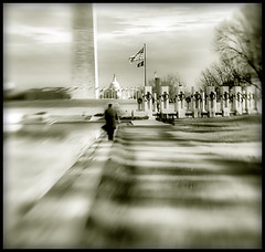 Lensbaby Washington (` Toshio ') Tags: trees bw blur sepia lensbaby clouds mall washingtondc dc washington path flag americanflag flags national lincolnmemorial dreamy reflectingpool wreaths wwiimemorial capitolbuilding worldwariimemorial toshio mywinners platinumphoto selectiveblurwashington monumentmanwaterblack whitetonedlensbaby composercapitolnational