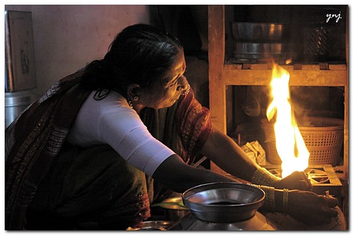 Cooking or Fire? (environmental portrait)