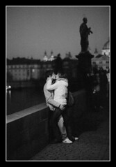Lovers at the Charles' bridge (ondrej_p) Tags: bw hug kiss couple prague availablelight praha olympus lovers ilfordxp2super charlesbridge keeper om2n zuiko50mmf14 200802402