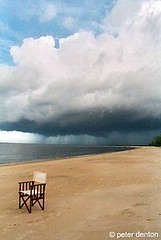 Approaching storm (Peter Denton) Tags: africa beach nature water weather clouds 35mm tanzania sand chair scanned analogue minimalism storms picnik lifeisart saadani bestminimalshot peterdenton
