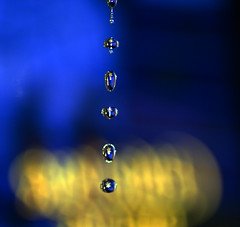 Water Tower (Michelle in Ireland) Tags: blue water yellow vertical drops searchthebest row falling drips dripping cubism iloveit dropping mywinners diamondclassphotographer flickrdiamond theunforgettablepictures acg1stplacewinner