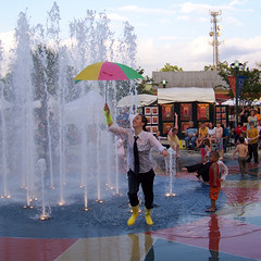 FIDL 08 2561 (Jobe Roco) Tags: pink music green water fountain yellow umbrella dance louisiana lafayette performance streetscene 2008 2561 festivalinternationaldelouisiane z712is