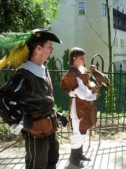 slovakia. falconers and falcon (kexi) Tags: boy shadow 2 two people sunlight man bird castle hat fence nikon may falcon coolpix slovensko slovakia 2008 easterneurope falconers bojnice instantfave bojnicecastle brillianteyejewel