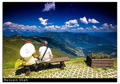 Watching Zell AM See (Hussain Shah.) Tags: old blue mountain d50 austria nikon couple view top watching sigma graduate 1020mm zellamsee enjoying kuwaiti shah hussain cokin gnd mywinners muwali favouritecapture