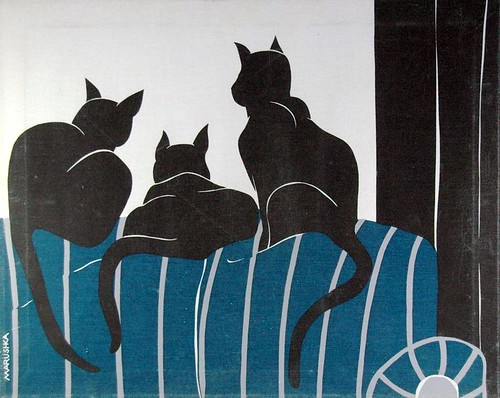 Marushka - three black cats on blue striped couch