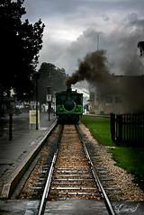 Rain on the Train... (*elySoft*) Tags: sky rain clouds train canon germany bayern grey nuvole grigio smoke grau zug cielo pioggia treno chiemsee regen germania rauch fumo baviera golddragon eos400d goldstaraward