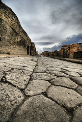 Pompeii Pathway (` Toshio ') Tags: street italy building history architecture clouds buildings walking volcano alley rocks europe roman bricks perspective tourists walkway mountvesuvius pompeii vesuvius hdr europeanunion toshio