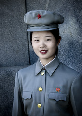 Young soldier girl - North Korea (Eric Lafforgue) Tags: pictures travel woman cute girl beauty asian soldier army photo nice women war asia military picture korea kimjongil cap asi